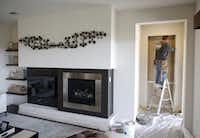 Jose Garcia of Dallas works on sheetrock inside a MainVue Homes Geneva Q1 model home at Phillips Creek Ranch in Frisco, on Tuesday, February 17, 2015. (Vernon Bryant/The Dallas Morning News) 02272015xBIZVernon Bryant - Staff Photographer