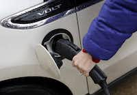 """After GameStop installed its charging stations, """"a couple of employees went out and bought electric cars,"""" said spokeswoman Larine Nixon. """"All four are used daily."""" Now the company is thinking of adding more."""