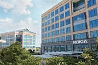 Marketing services firm Epsilon is moving into Nokia's building in Las Colinas as the mobile phone firm relocates to a smaller space nearby.