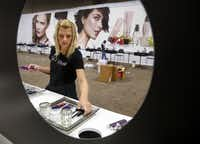Mary Kay project manager Jennifer Harris unboxes the Limited Edition Trend Collection as she sets up a demo station in preparation for the Mary Kay 50th Anniversary seminar at the Dallas Convention Center.