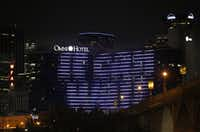 AT&T's It Can Wait message was displayed on the Omni Hotel in downtown Dallas last week. The campaign has gotten the support of competitors Verizon, T-Mobile and Sprint.