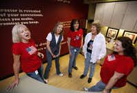 Employees of Group & Pension Administrators Inc. Paula Welborn (from left), Clyde New, Joanie Verinder, Debbie Jones and Sammi Breedlove have a fun moment at the coffee lounge during their dress-down patriotic T-shirt day. Staff can donate $5 to a charitable organization to participate in the dress-down days.