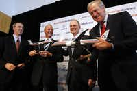 At the news conference announcing American's huge aircraft order were (from left) Tom Horton, president of AMR and American; Tom Enders, Airbus president and CEO; Gerard Arpey, AMR and American chairman and CEO; and Jim Albaugh, Boeing Commercial Airplanes president and CEO.