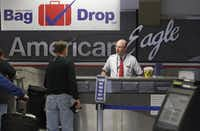 The American Eagle ticketing area in Terminal B at DFW Airport. (Louis DeLuca/The Dallas Morning News)