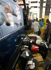 Passengers line up for boarding. Greyhound has been overhauling its fleet with new engines and interiors to serve 10.5 million riders annually, a number it hopes to triple.(Photos by Louis DeLuca - Staff Photographer)