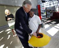 Richard Fisher,  president and CEO of the Dallas Federal Reserve Bank, gave a tutorial on how to take out a loan to 50 young students who are participating in Dallas' Lemonade Day.( Mona Reeder  -  Staff Photographer )