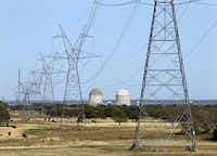Electrical transmission lines lead to Luminant's Comanche Peak Nuclear Power Plant near Glen Rose, Texas, Wednesday, March 23, 2011. Reactor Units 1, right, and 2 can be seen at the plant.