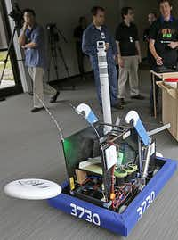Test engineer Rachel Moore worked with other TI employees and a dozen high school students to build a disc-throwing robot in six weeks.