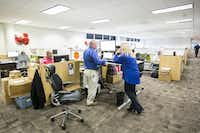 Workers chat around a standing workstations furnished by Haworth at the Toyota North America temporary offices on Tuesday, Sept. 22, 2015, in Plano. Toyota is trying out different designs from four manufacturers for its new headquarters being built in Plano.Smiley N. Pool  -  Staff Photographer