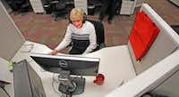 Corinne Moore, 83, has a seasonal customer service job for a Towers Watson health exchange in Richardson.  She is pictured here at the office on Thursday, November 21, 2013.Louis DeLuca - Staff Photographer