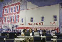 "A painting depicting Wal-Mart founder Sam Walton's first five-and-time store adorns a wall at the company's new ""Talent Center"" in Irving. Wal-Mart is taking hiring and training out of stores and consolidating those functions at the new center.Michael Ainsworth - Staff Photographer"
