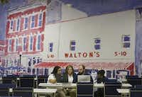 "A painting depicting Wal-Mart founder Sam Walton's first five-and-time store adorns a wall at the company's new ""Talent Center"" in Irving. Wal-Mart is taking hiring and training out of stores and consolidating those functions at the new center.(Michael Ainsworth - Staff Photographer)"