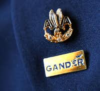Beverley Bass of Argyle never removed the Gander, Newfoundland, pin she received while stranded there following 9/11 terrorist attacks; she kept it on her uniform lapel beneath her 30-year pin from American Airlines.