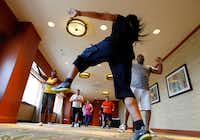 Ernesto Plazola leads a Zumba class for Sheraton Hotel employees in downtown Dallas.