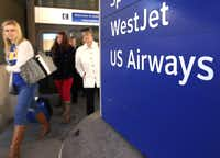 Among the tasks facing the merged airlines will be changing airport signs and moving gates at many airports. The merger also will require new uniforms for many employees. And the new airline must repaint airplanes so they all look alike.