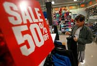 Alvaro Abrego takes a look at sweat pants at the Dick's Sporting Goods store at The Shops at Park Lane in Dallas. (Jae S. Lee/The Dallas Morning News)