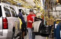 General Motors worker Daniel McGee carries a bumper part of a new GM SUV while he works at the General Motors Assembly Plant in Arlington, Texas on March 28, 2014. (Kye R. Lee/The Dallas Morning News) 05042014xNEWS