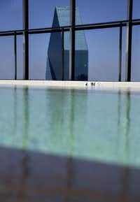 The Fountain Place skyscraper peeks above a swimming pool at the LTV Building Tuesday, July 28, 2015 in Dallas. The decades-old building is currently being renovated by New Orleans-based HRI Properties, LLC. Once completed, it will house a mixed-use complex featuring luxury apartments and a Hilton hotel.(G.J. McCarthy - The Dallas Morning News)