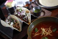 Tacos and tortilla soup plated at Sky Canyon by Stephan Pyles.