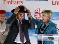 Fort Worth Mayor Betsy Price gave United Arab Emirates Ambassador Yousef Al Otaiba a cowboy hat as Emirates launched its new service from D/FW to Dubai.