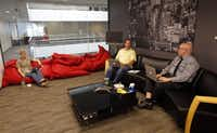 Marketing manager Adrienne Thomas (left) talks with Darin Newbold and Chris Koeberle in a meeting room at Bottle Rocket Apps.