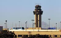 The Skylink passes a tower at D/FW International Airport.