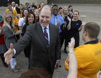 Southwest Airlines CEO and Chairman Gary Kelly reaches out to his employees before he attends a Dallas City Council hearing on the future of two gates Southwest Airlines and Virgin America are competing for at Dallas Love Field.David Woo  -  Staff Photographer