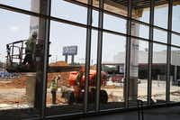 Toyota of Irving's new showroom is partly an answer to Toyota's push for its dealers to upgrade their facilities and improve customer service.( David Woo  -  Staff Photographer )