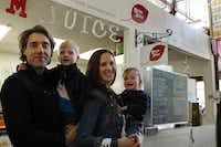"<bold>Boom Juice owners</bold> Davio and Jessica Ventouras, with sons Winston (left) and Hudson, ""lived in the epicenter of the juicing industry"" in New York City.<252><252>Evans Caglage - Staff Photographer"