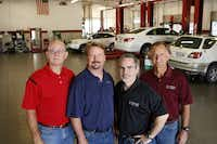 From left: Craig Davenport, Daniel Davenport, Jimy Wright and David Davenport are the faces behind Davenport Motor Co.'s distinctive blue and white facade.