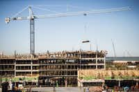 Construction crews work on the Legacy West mixed-use development on the north west corner of the intersection of Legacy Drive and the Dallas North Tollway on Thursday, December 3, 2015 in Plano, Texas.Ashley Landis  -  Staff Photographer