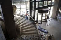 A worker cleared debris from a stairway during an office complex renovation at 290 E. John Carpenter Freeway in Las Colinas. The area's office market has seen a six-month surge in leasing that seems likely to continue.