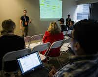 "Austin Wells (left), executive director at HackDFW, answers a question during a session called ""Hackathon 101"" at Dallas Startup Week activities on Tuesday, April 12, 2016 at 1700 Pacific Avenue in Dallas.  (Ashley Landis/The Dallas Morning News)(Ashley Landis - Staff Photographer)"