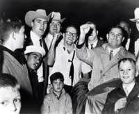 President Lamar Hunt of the Dallas Texans celebrates with his team after they defeated the Houston Oilers in a 20-17 overtime win in the 1962 AFL Championship Game on December 23, 1962 at Jeppesen Stadium in Houston, Texas.   1962 AFL Championship Game - Dallas Texans vs Houston Oilers - December 23, 1962