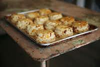 Cheddar biscuits prepared by chef Robert Lyford at Patina Green Home and Market in McKinney.(Andy Jacobsohn - Staff Photographer)
