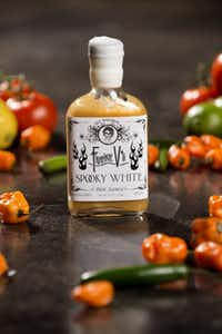 A bottle of Frankie V's top selling Spooky White hot sauce is photographed at his warehouse Tuesday, July 23, 2013 in Dallas. Frankie Valdez, creator of Frankie V's Kitchen, has written screenplays and worked in information technology but recently turned his passion for food into a business.