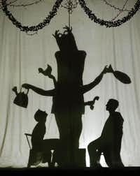 Cast members (from left) Gracie Cuny, Jacky Burak and Dakota Ratliff perform behind a backdrop.( Nathan Hunsinger  -  Staff Photographer )