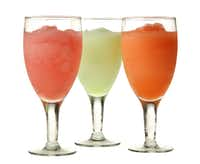 Mixes from Texarkana-based Wine-A-Rita include (from left): Cosmo Rita, Senorita and Peach Bellini.