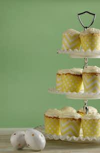 Cream cheese frosting tops cupcakes with a touch of lime curd inside.Evans Caglage  -  Staff Photographer