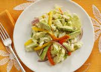 Napa Cabbage Salad with Avocado and Bell Pepper can be plated ahead of time, or served from a bowl at the table.