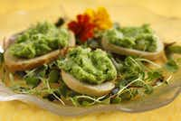 Green Pea Dip works as a dip -- or you can spread it on toasts set on a bed of micro greens.