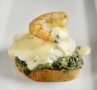 Call it jumbled shrimp Eggs Benedict. Starting at the botttom, layer a toasted baguette, Stouffer's creamed spinach, a poached egg, hollandaise sauce with a pinch of tarragon and cooked shrimp.