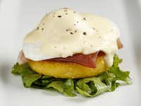 Dress arugula with vinaigrette and pile on polenta and prosciutto, the egg and hollandaise sauce.