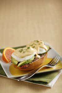 Start with a split toasted bolillo roll spread with refried black beans and grated cheese; broil to melt cheese, then top with bacon, avocado, poached eggs, and hollandaise sauce spiked with a little chipotle chile in adobo sauce. Napkin, Crate and Barrel; Fork, World Market