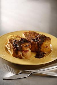 Baked Stuffed Savory French Toast is adapted from a recipe on marthastewart.com.Evans Caglage - Staff Photographer; food styling: Tina Danze/Special Contributor; plate from Pier One