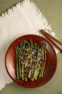 """Smoked pecans and shallots can accent the acidity of the asparagus perfectly,"" Dean Fearing says of his Roasted Asparagus with Smoked Texas Pecans."