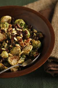 Whole Foods will have Brussels sprouts with raisins, bacon and almonds. And check in at the Holiday Table: You never know what you might find.