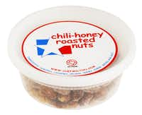 """Chili-Honey Roasted Nuts - Milton Aschner's sweet-and-spicy Chili-Honey Roasted Nuts, based in Richardson, just nailed a spot on Central Market's coveted shelves in January. Aschner's secret: He cooks the nuts in spices and North Texas honey. After a sales career in printing, Aschner lived the dream of attending culinary school. One night while working as personal chef, he whipped up a batch of sweet-hot roasted nuts for guests to munch before dinner. Score! """"People wanted to know if they could buy some,"""" he says. One thing led to another, and now he's making nuts and his new product, seasoned salts, fulltime."""