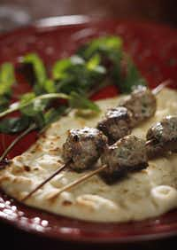 Kefta is a common Middle Eastern meatball that's cooked on a skewer and served with pita bread.