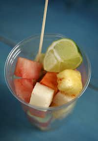 Fruit cups are seasoned with lime juice, salt and pure ground chile.